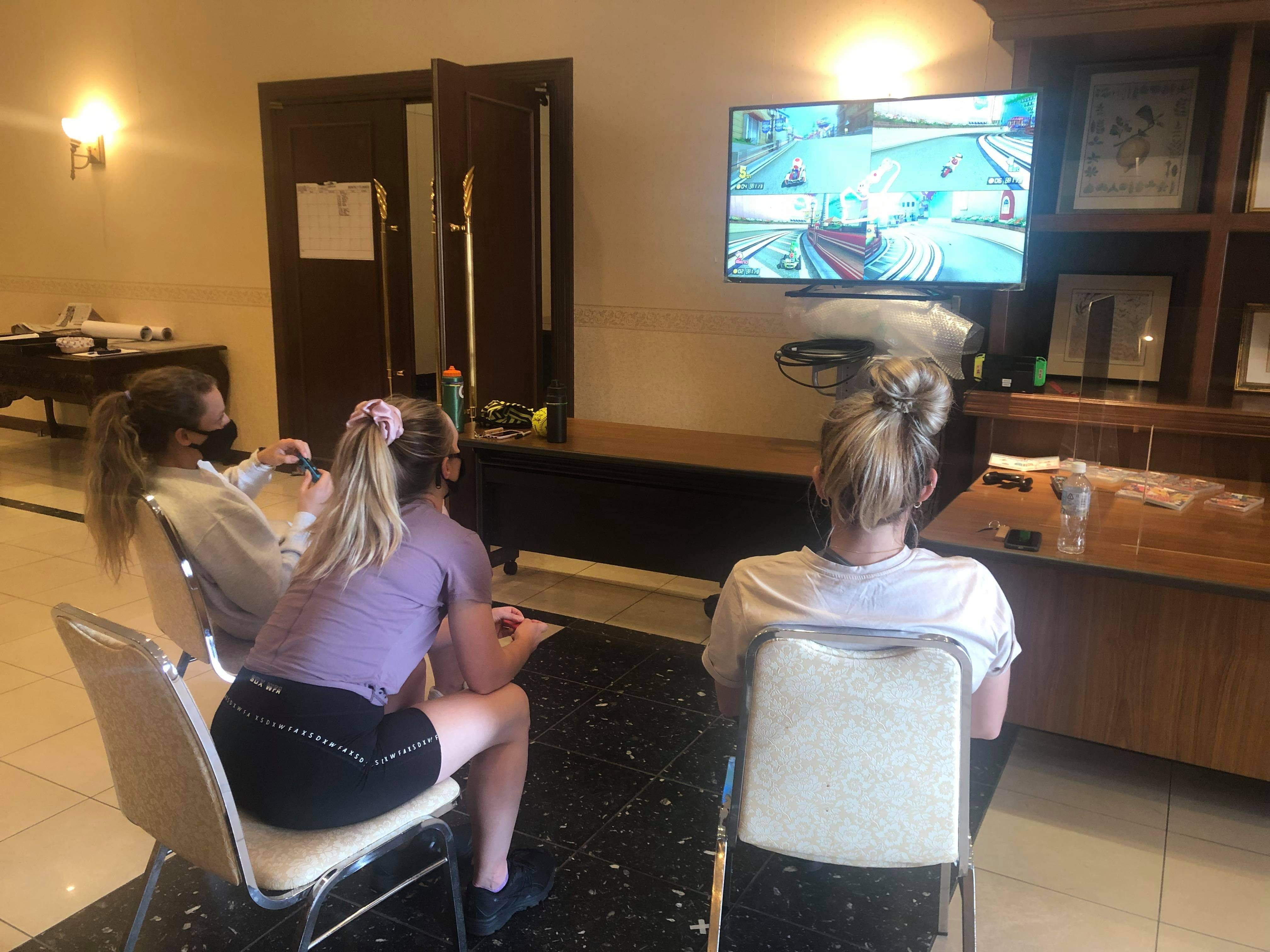 Australian softball players passing time by playing Nintendo Switch in their hotel in Ota, Japan.