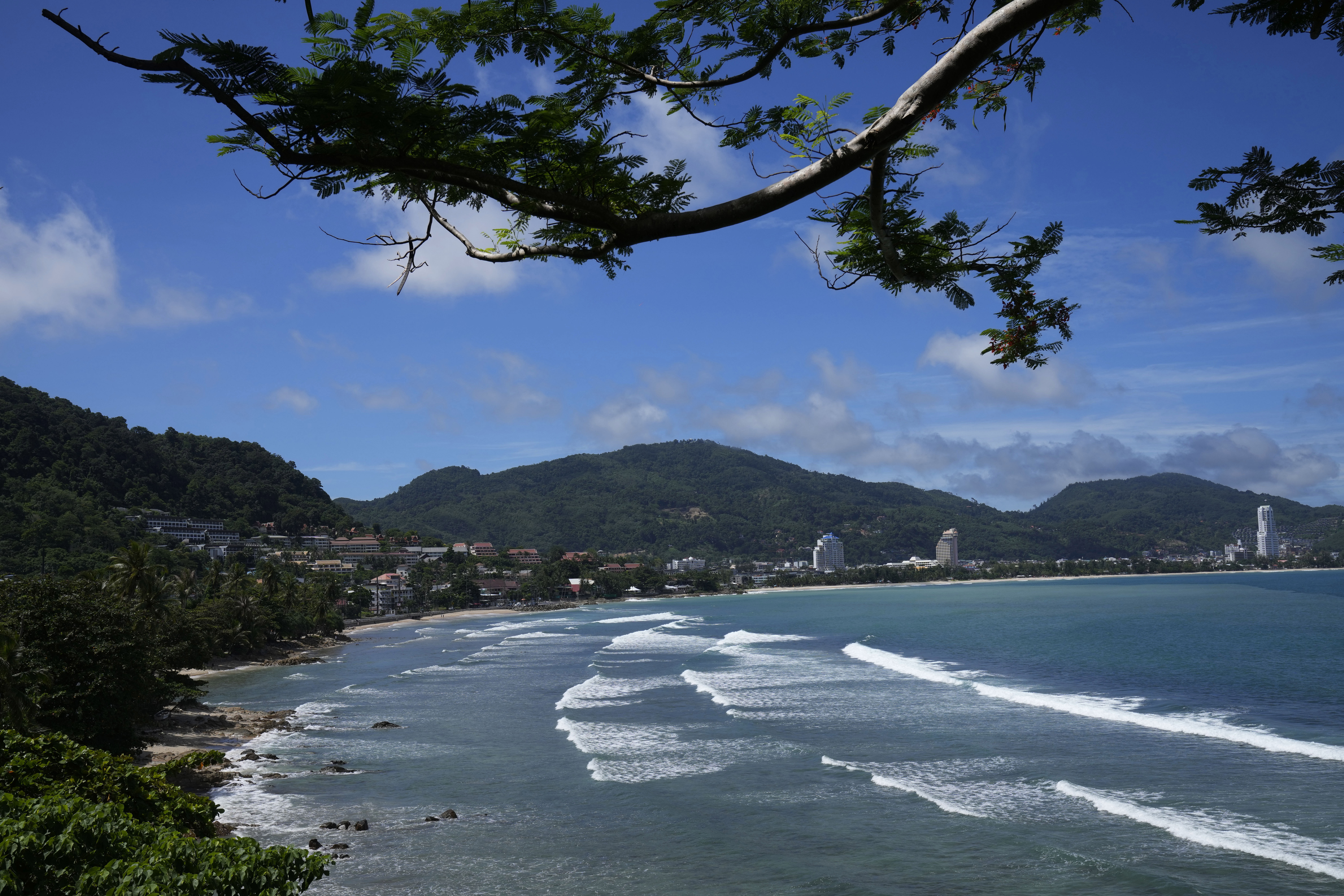 Waves break on the empty tourist beach of Patong on Phuket, southern Thailand, June 29, 2021.
