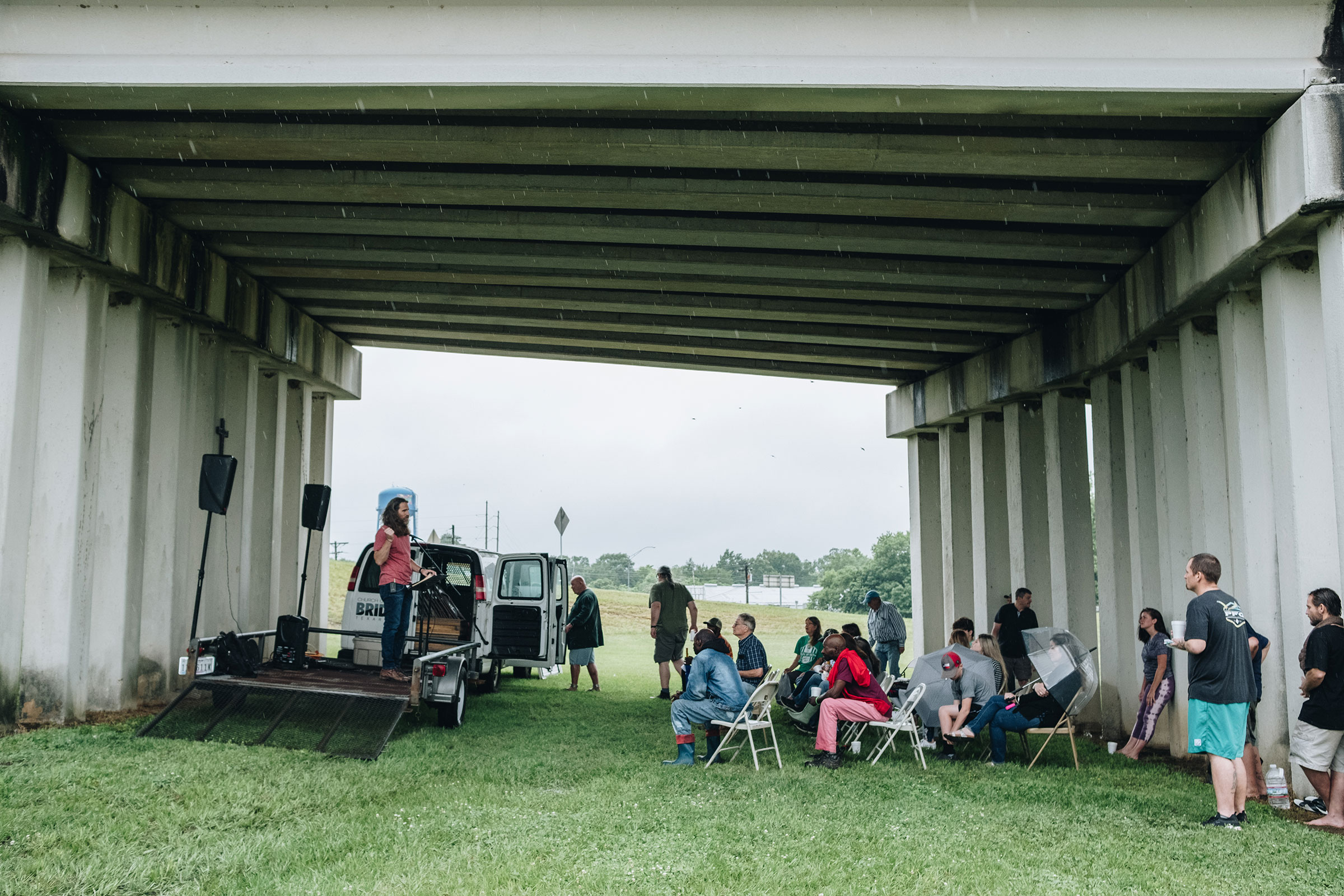 Pastor Cody Howard delivers a sermon to attendees of Church Under the Bridge