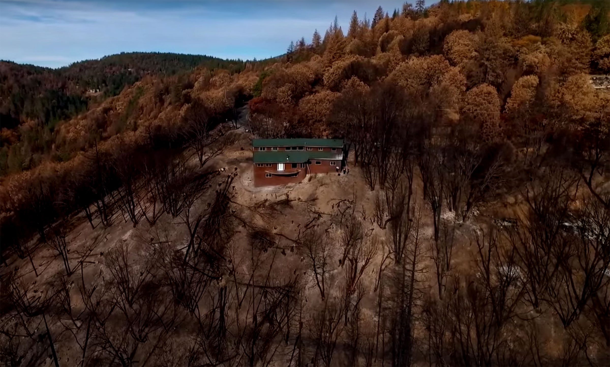 An aerial photo shows Sean Jennings' home surrounded by scorched land after a 2015 wildfire in northern California.
