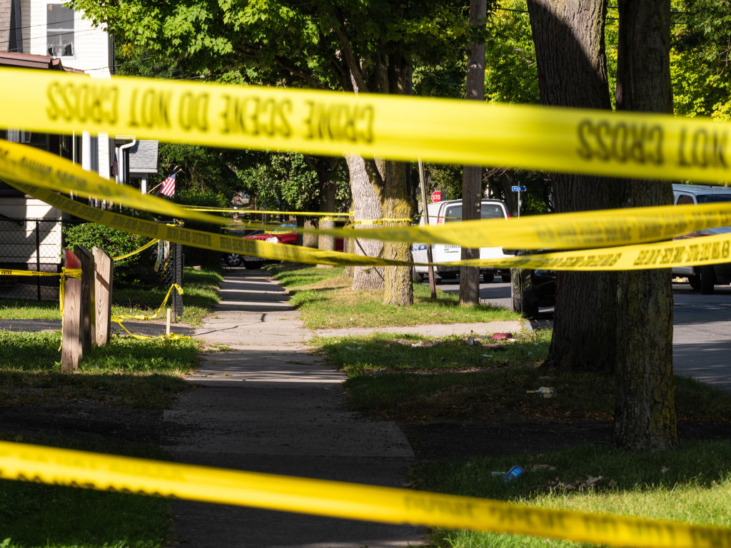 Police tape lines a crime scene after a shooting at a backyard party on September 19, 2020, in Rochester, New York.