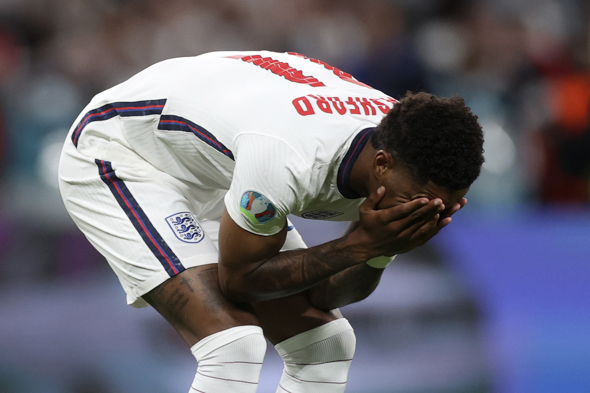 England's Marcus Rashford reacts after failing to score a penalty during a shootout at the end of the Euro 2020 soccer championship final match between England and Italy at Wembley stadium in London, Sunday, July 11, 2021.