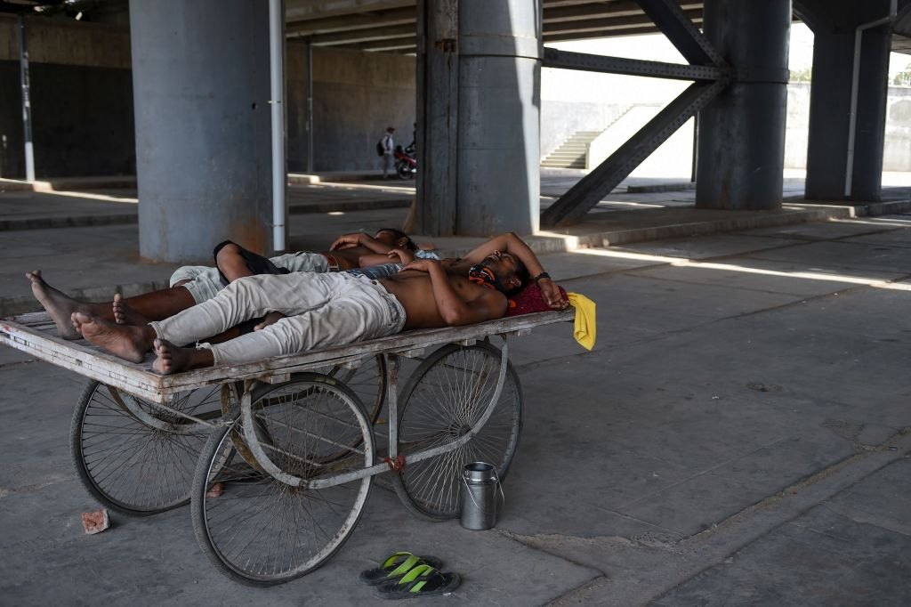 Men rest on a cart under a bridge near Sabarmati river during a hot day in Ahmedabad, India, on May 28, 2019.