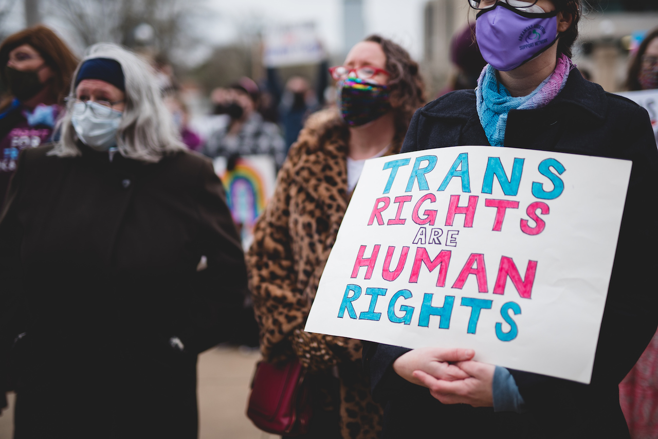 People protesting Arkansas House bill HB1570, which prevents doctors from providing gender-affirming care to patients under 18, on March 18 outside the Arkansas state House. The bill became law in April, but was temporarily halted by a judge on Wednesday.
