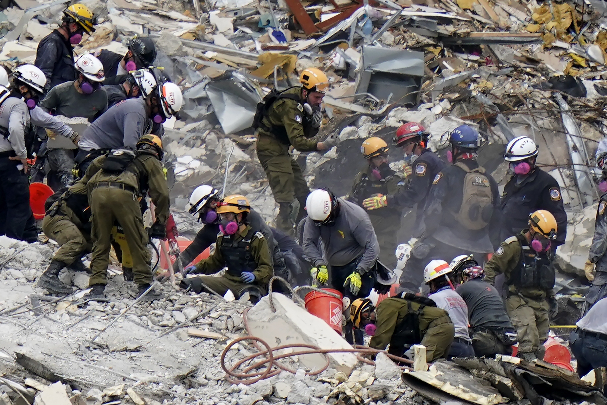 Crews from the United States and Israel work in the rubble Champlain Towers South condo in Surfside, Fla, on June 29, 2021.