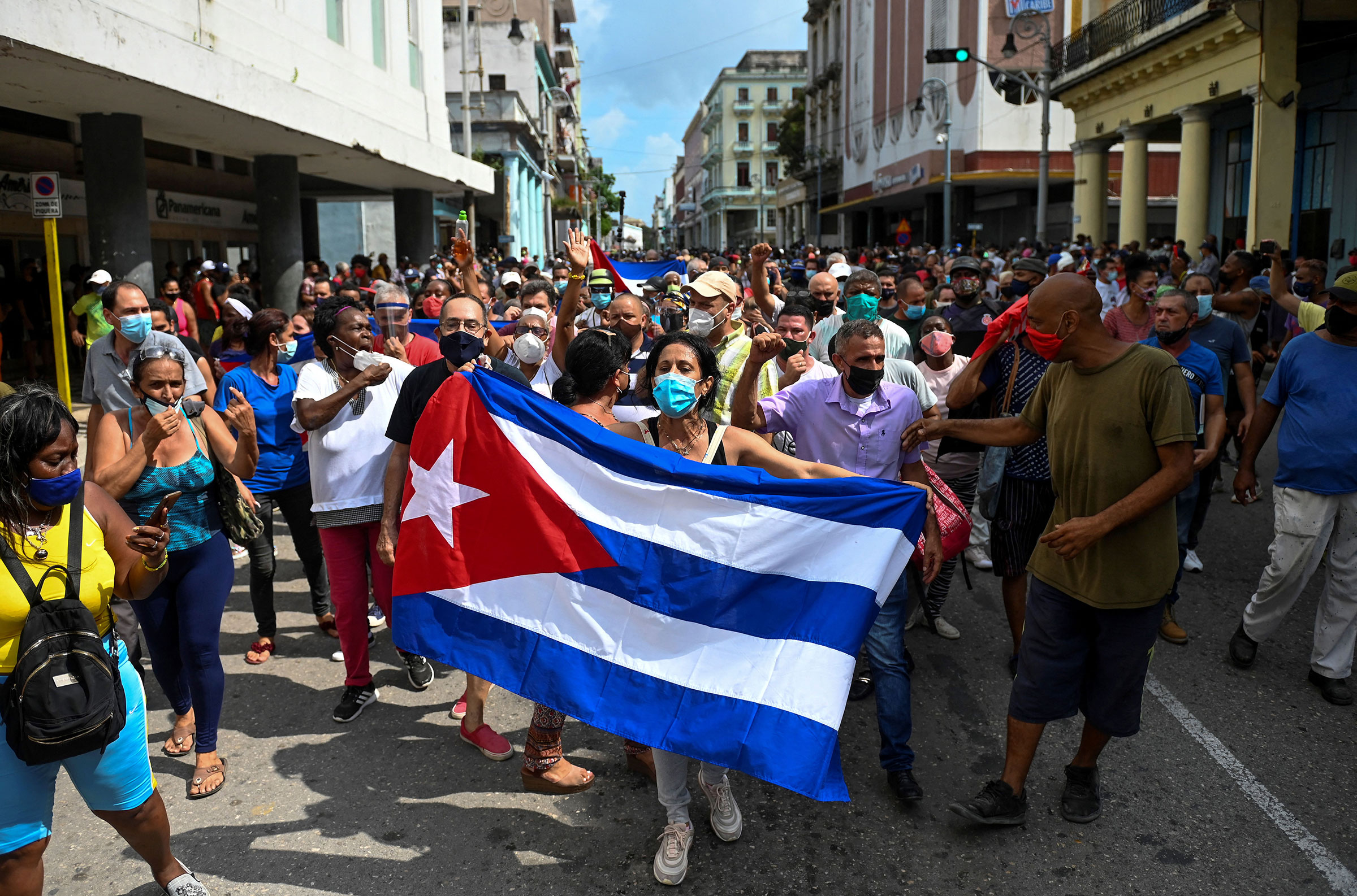 People take part in a demonstration to support the government of the Cuban President Miguel Diaz-Canel in Havana, on July 11, 2021. - Thousands of Cubans took part in rare protests Sunday against the communist government, marching through a town chanting  Down with the dictatorship  and  We want liberty.