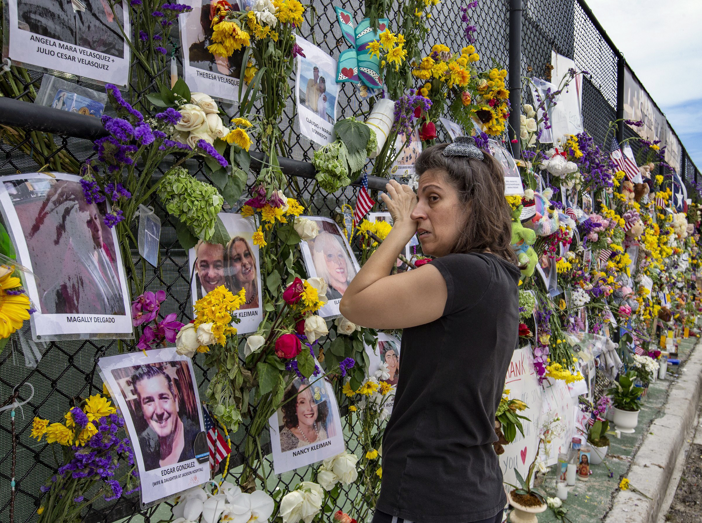 Gini Gonte visits the Surfside Wall of Hope and Memorial on Wednesday, July 7, 2021, as she honors her friends Nancy Kress Levin and Jay Kleiman, who lost their lives after the collapse of the Champlain Towers South in Surfside, Fla.