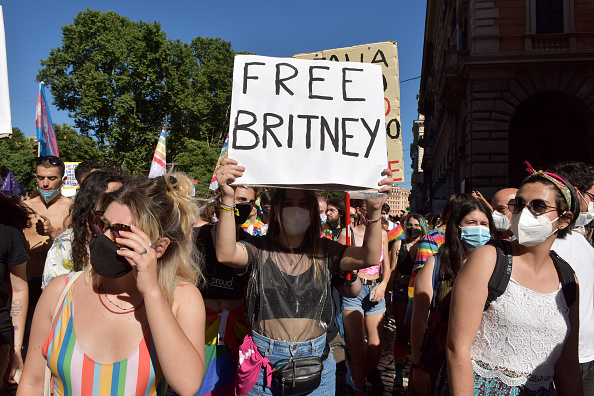 Person with a  Free Britney  sign takes part in the Rome Pride parade in Rome, Italy, on June 26, 2021.