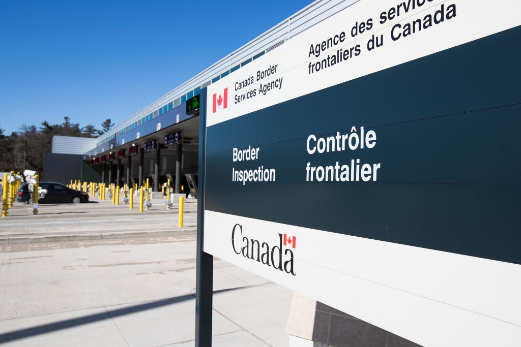 A vehicle enters a Canadian border station at the US-Canada border after the two countries closed their border for all non-essential travel in Lansdowne, Ontario, on March 22, 2020.