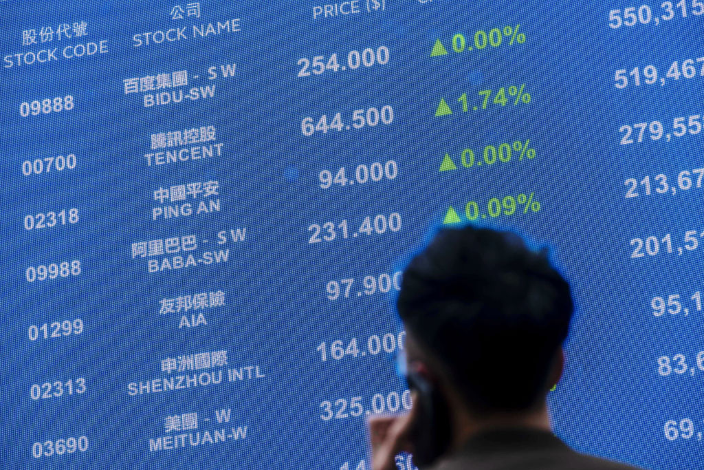 Share prices of companies including Baidu Inc. at the Exchange Square complex in Hong Kong, China, on Tuesday, March 23, 2021.