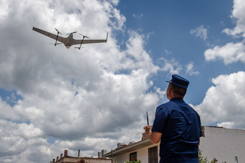 A staff member uses a drone to track and monitor the wild Asian elephants in Hongta District, Yuxi City, southwest China's Yunnan Province, June 1, 2021.