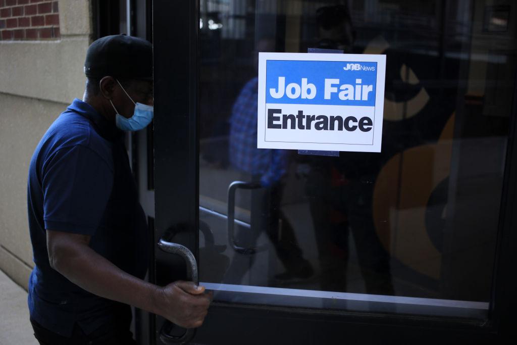 A job seeker wearing a protective mask arrives at a Job News USA career fair in Louisville, Kentucky, U.S., on Wednesday, June 23, 2021.