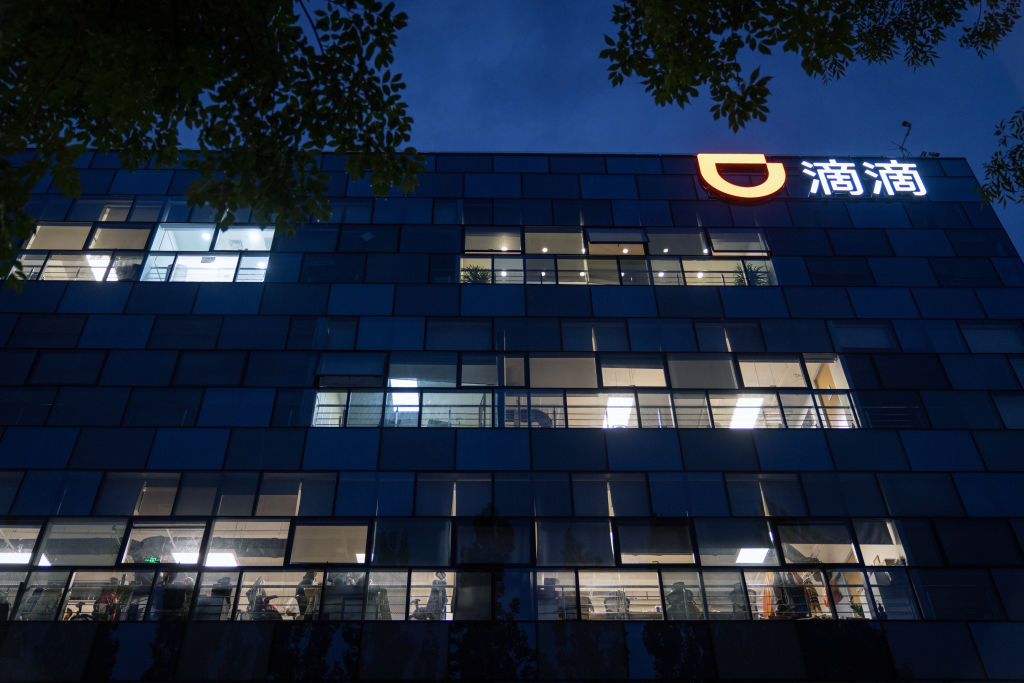 Illuminated office windows at the Didi Global Inc. headquarters at night in Beijing, China, on Monday, July 5, 2021.