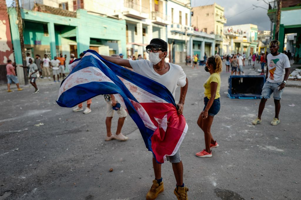 A man waves a Cuban flag during a demonstration against the government of Cuban President Miguel Diaz-Canel in Havana, on July 11, 2021.