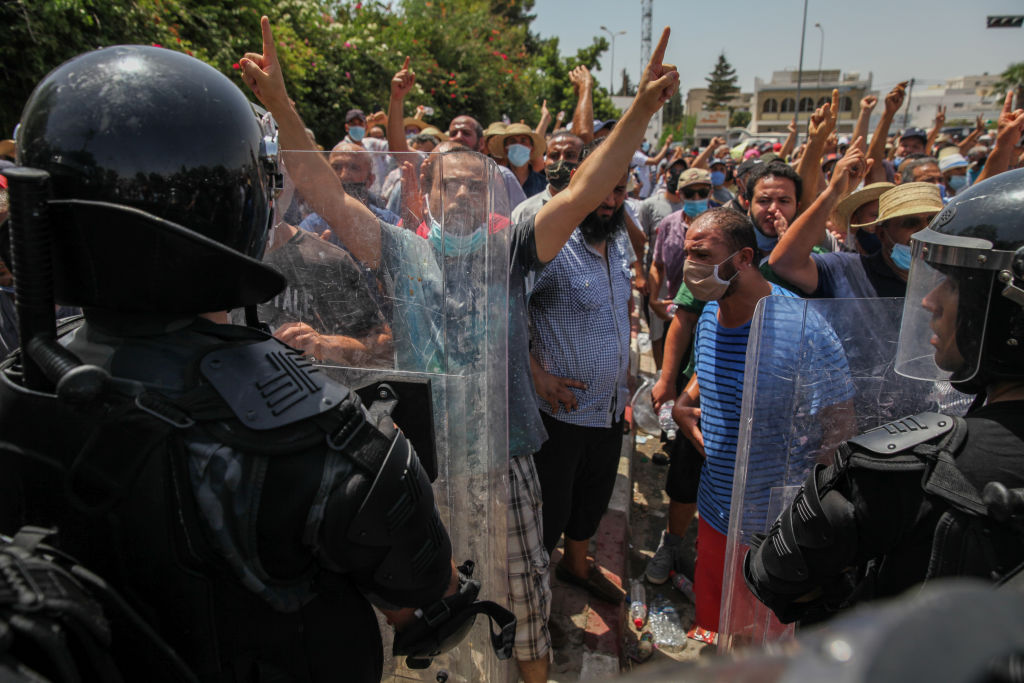 Supporters of the Islamist party Ennahdha in front of the riot police in front of the Tunisian parliament in Bardo, in the capital Tunis, Tunisia, on July 26, 2021