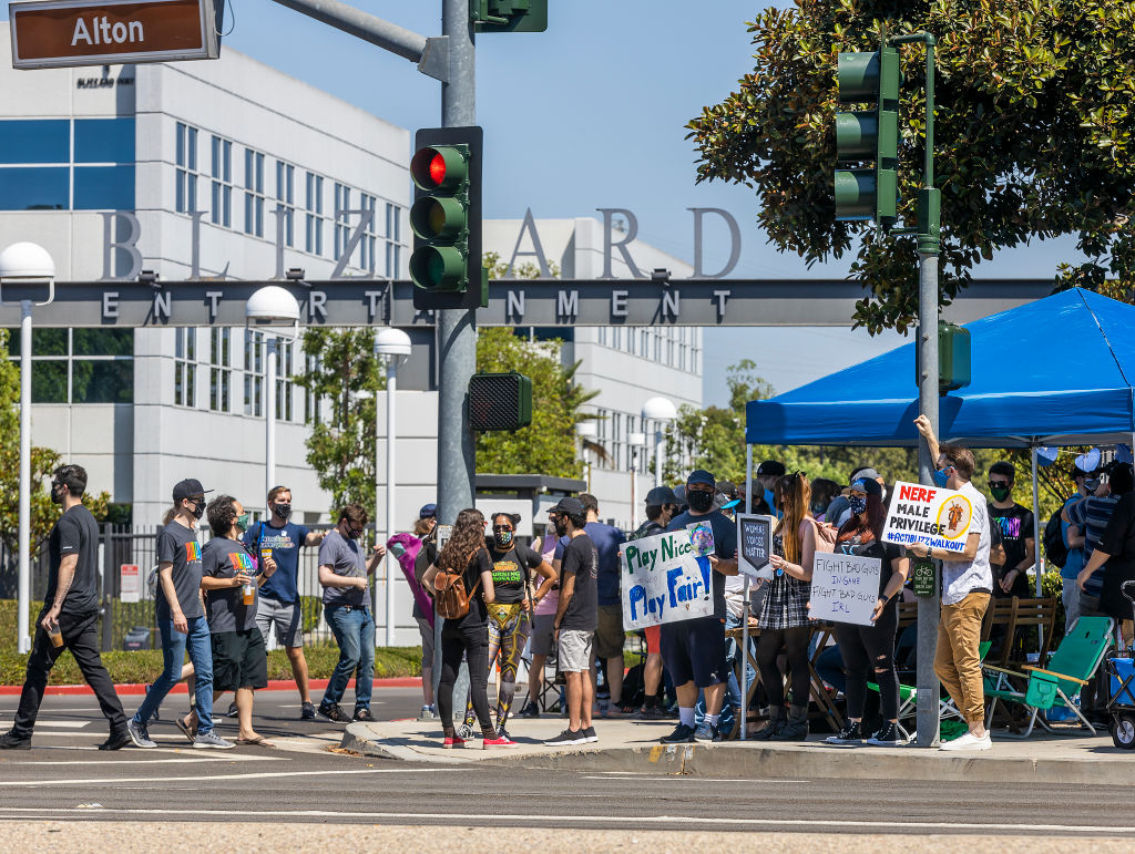 Several hundred Activision Blizzard employees stage a walkout which they say is in a response from company leadership to a lawsuit highlighting alleged harassment, inequality, and more within the company outside the gate at Activision Blizzard headquarters on July 28, 2021 in Irvine, Calif.