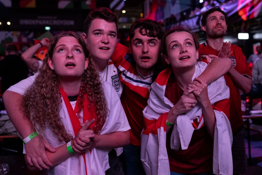 Tense England fans watch the final few minutes of the live broadcast of the semi-final match between England and Denmark at BOXPARK Croydon on July 07, 2021 in London, England