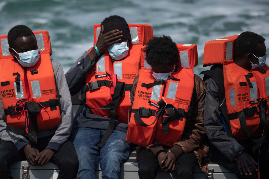 Migrant men arrive at Dover Port after being picked up in the English Channel by the Border Force on July 21, 2021 in Dover, England