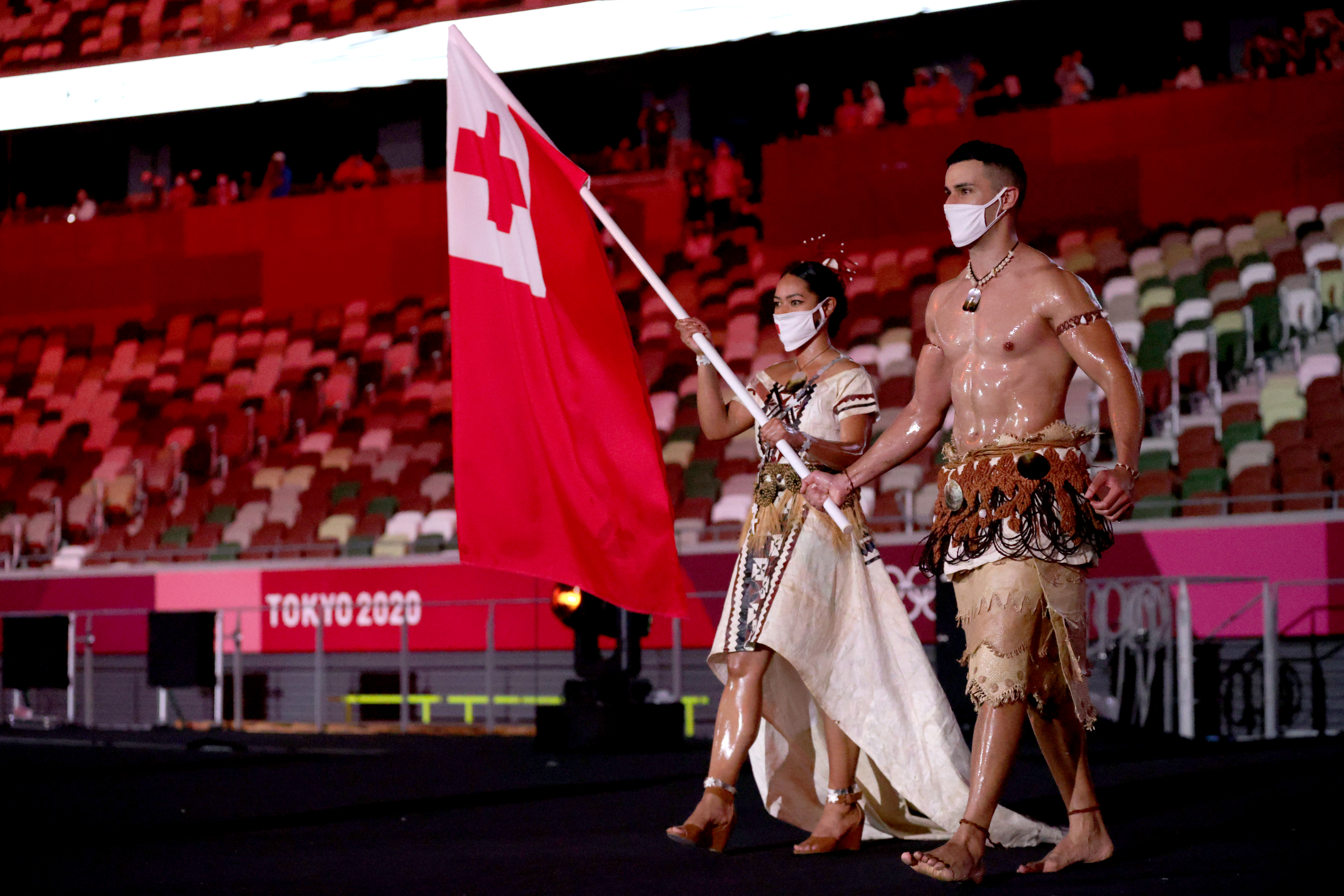 Flag bearers Malia Paseka and Pita Taufatofua of Team Tonga lead their team during the Opening Ceremony of the Tokyo 2020 Olympic Games at Olympic Stadium on July 23, 2021 in Tokyo, Japan.