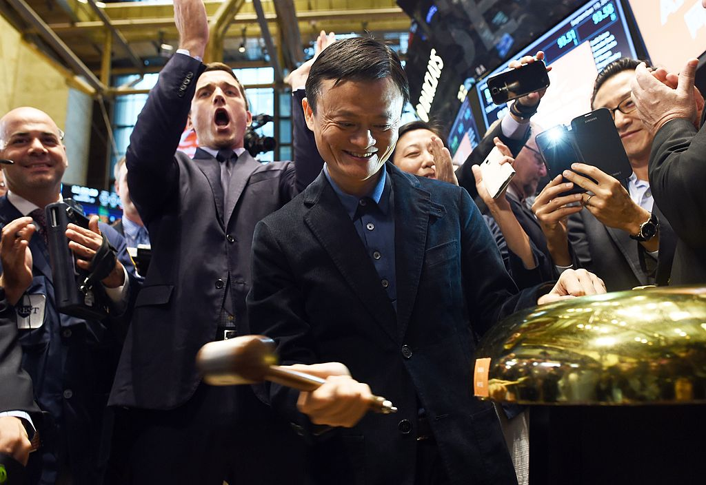 Chinese online retail giant Alibaba founder Jack Ma (C) rings a bell to start the trading of his company's stock on the floor at the New York Stock Exchange in New York on September 19, 2014.