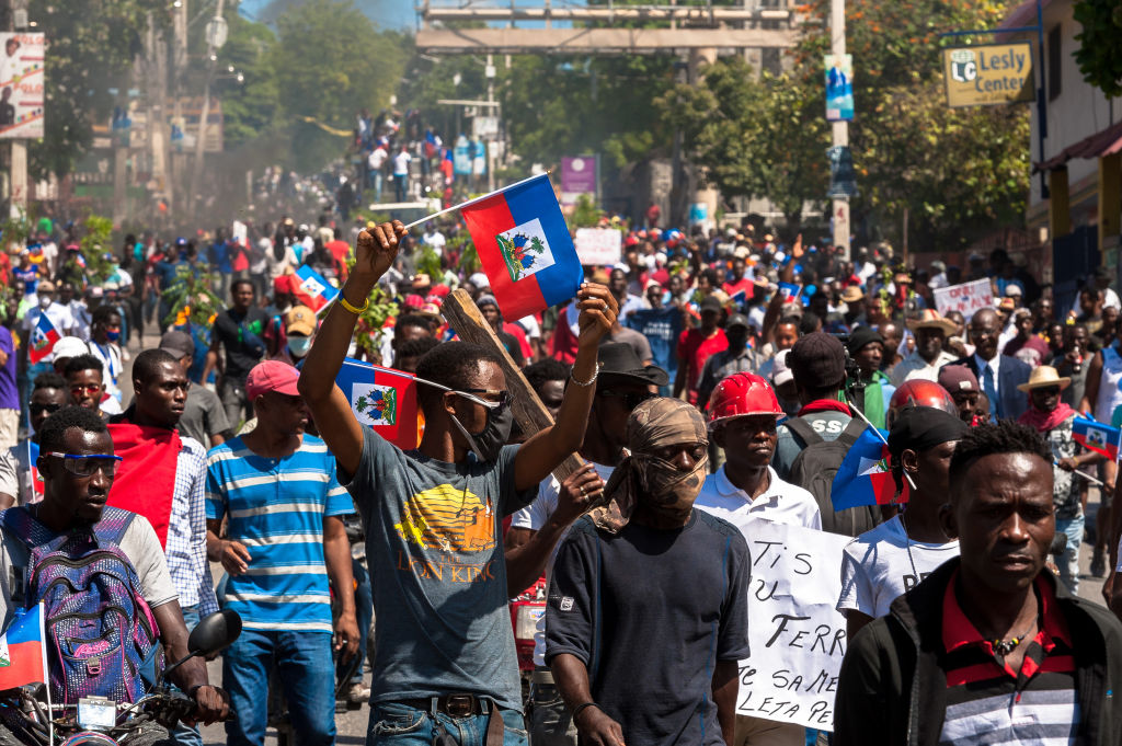 Haitians demonstrate during a protest to denounce the draft constitutional referendum carried by the President Jovenel Moise on March 28, 2021 in Port-au-Prince, Haiti.