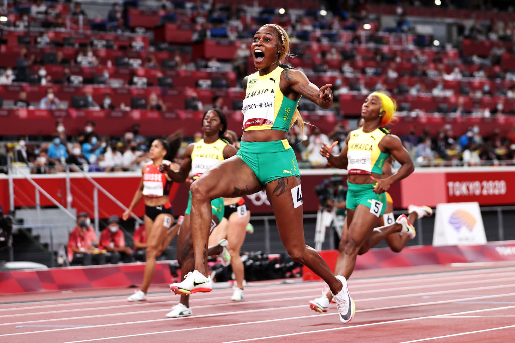 Elaine Thompson-Herah of Team Jamaica crosses the finish line to win the gold medal in the Women's 100m Final on day eight of the Tokyo 2020 Olympic Games at Olympic Stadium in Tokyo, Japan, July 31, 2021.