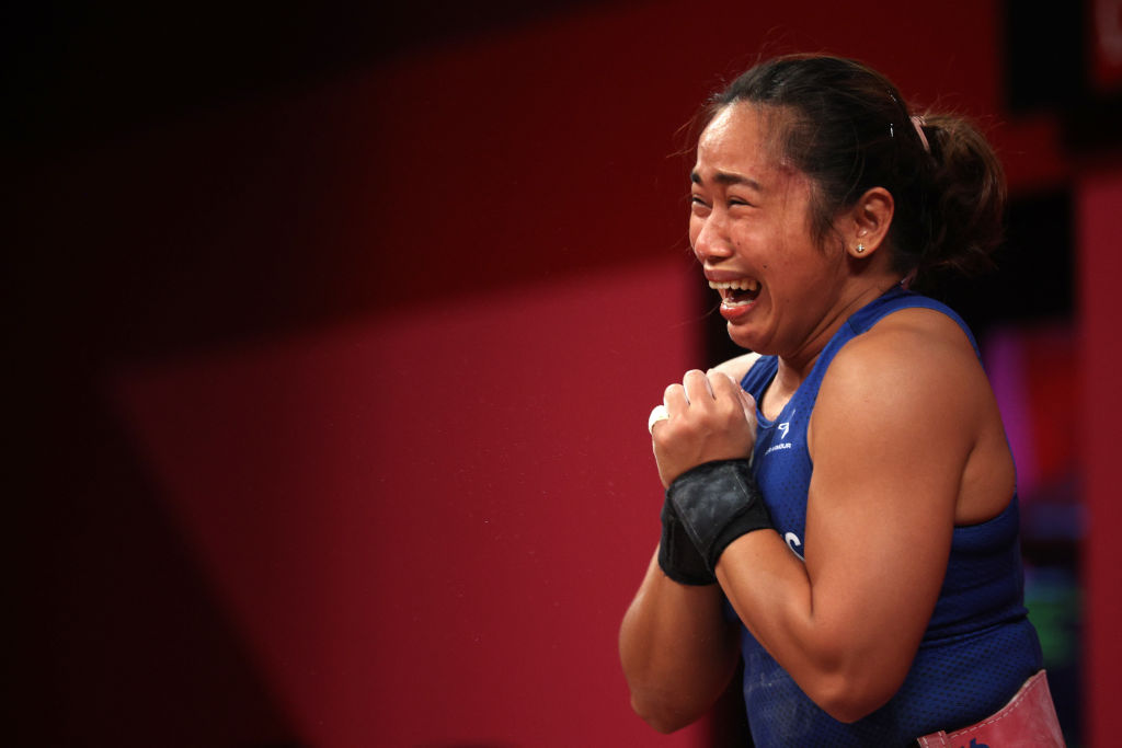 Hidilyn Diaz of Team Philippines competes during the women's weight lifting 55kg competition on day three of the Tokyo 2020 Olympic Games at Tokyo International Forum on July 26, 2021 in Tokyo, Japan.