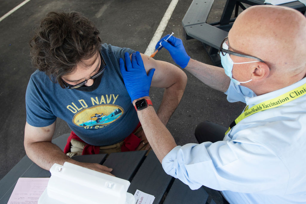A man receives a J&J vaccine at a clinic in Portland, ME on June 2.