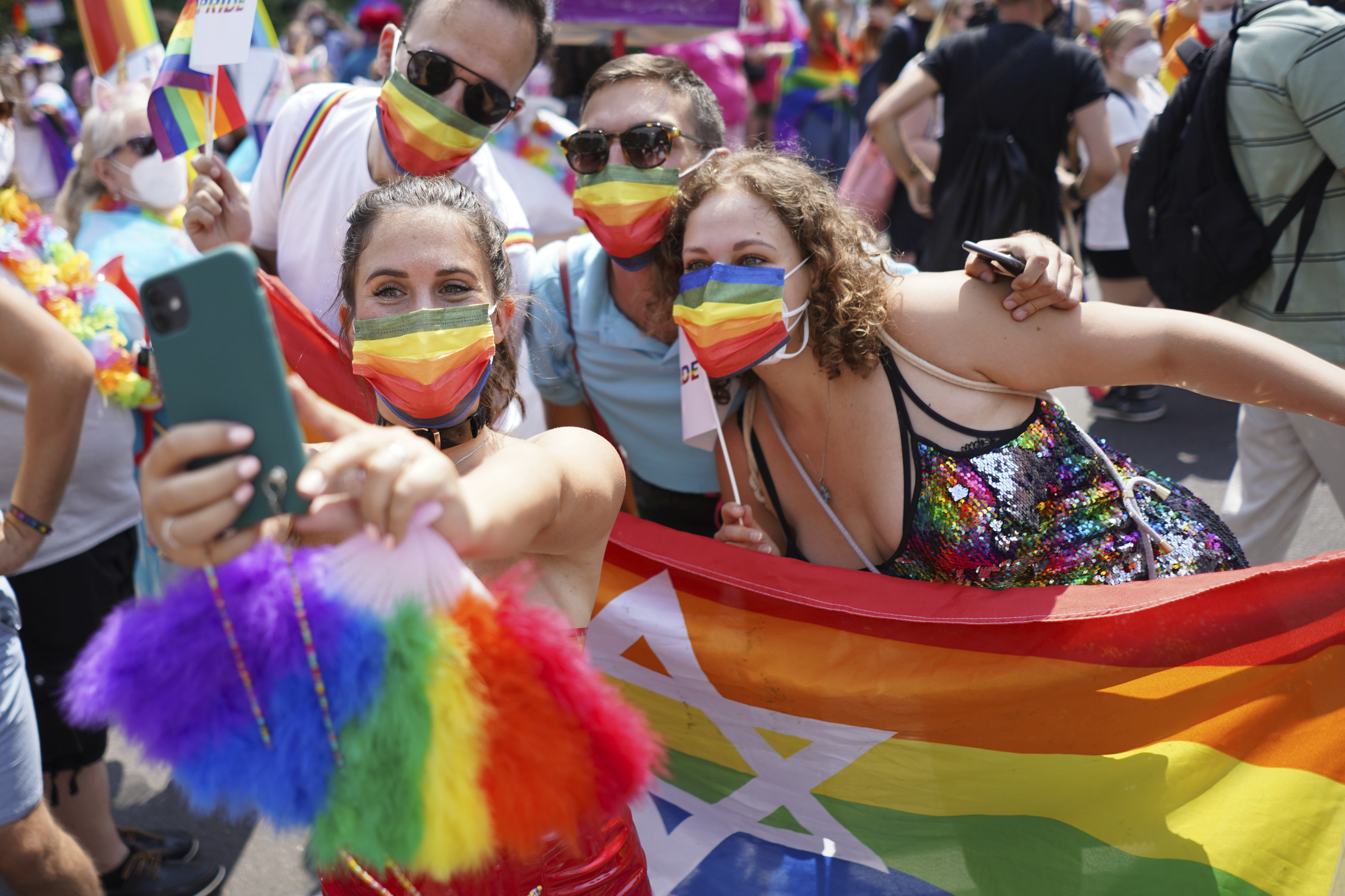 People take part in the Christopher Street Day (CSD) parade, in Berlin, on July 24, 2021.