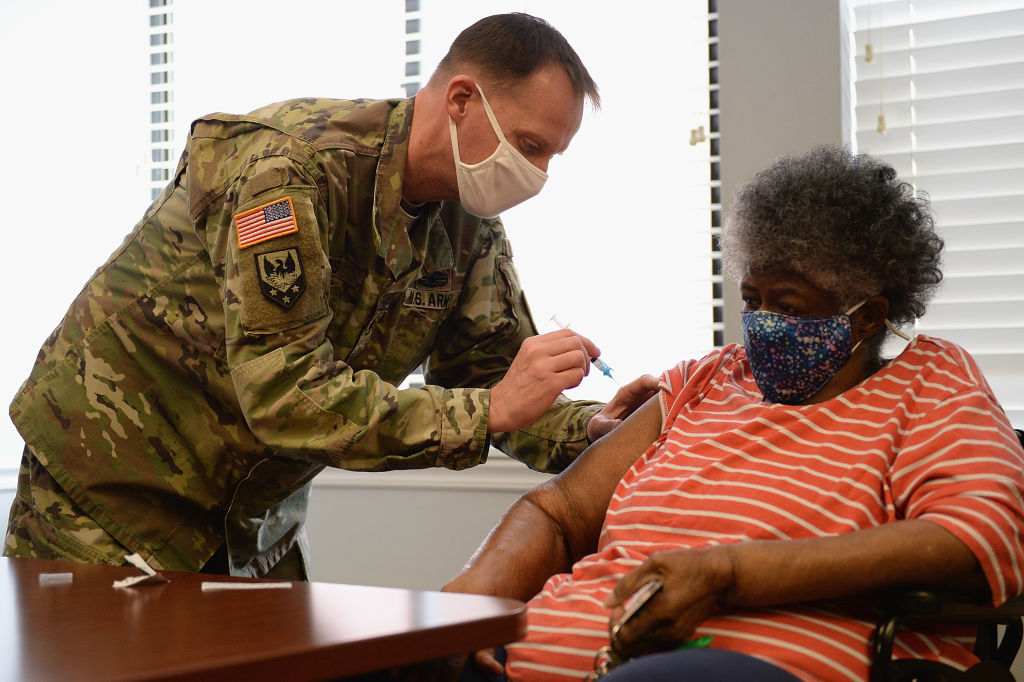 A member of the Missouri Army National Guard administers a Covid-19 vaccine on February 11, 2021 at a senior living facility in St Louis.