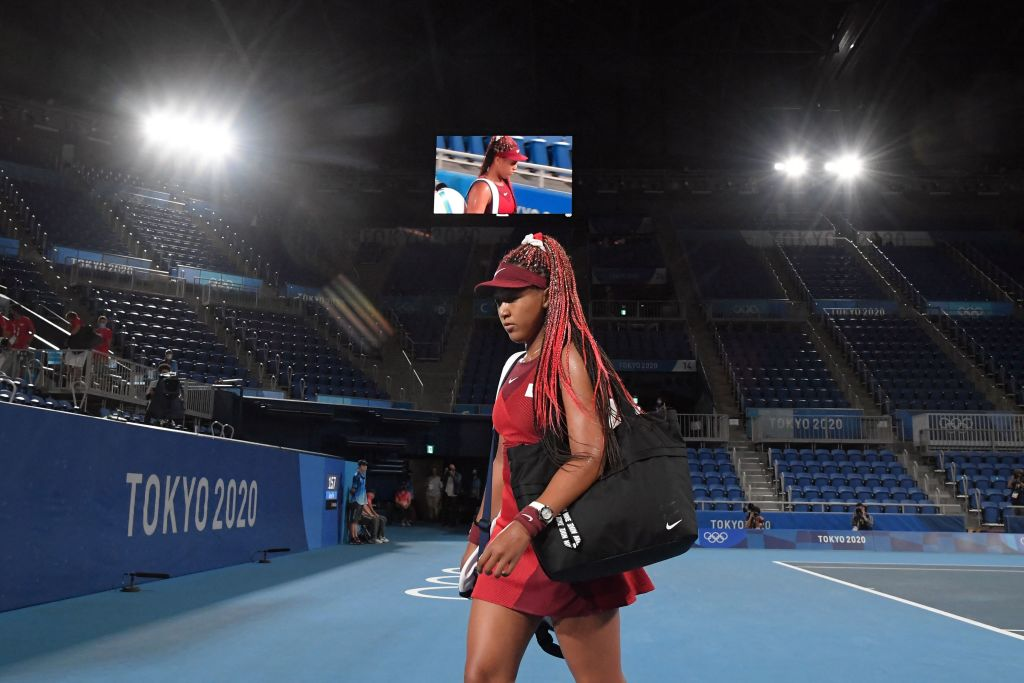 Japan's Naomi Osaka leaves the court after being beaten by Czech Republic's Marketa Vondrousova in their Tokyo 2020 Olympic Games women's singles third round tennis match at the Ariake Tennis Park in Tokyo on July 27, 2021.