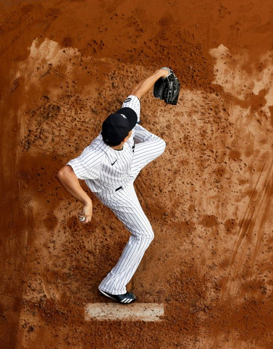 Masahiro Tanaka of the New York Yankees warms up in the bullpen before a game against the Atlanta Braves on August 12, 2020 in New York City.