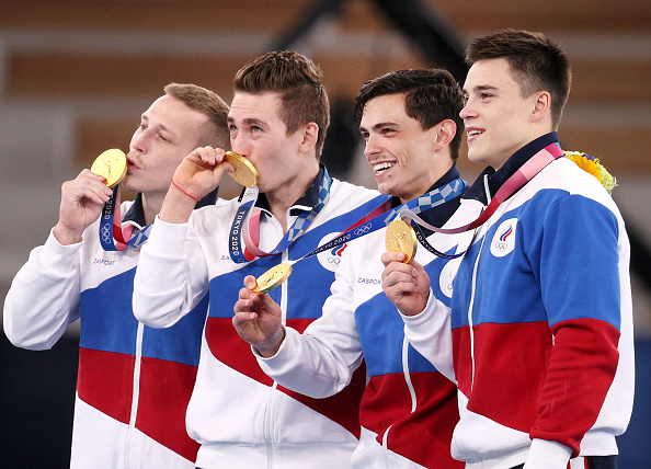 ROC athletes awarded gold medals during the victory ceremony after the men's artistic gymnastics final team all-around event held at the Ariake Gymnastics Centre as part of the 2020 Summer Olympic Games.