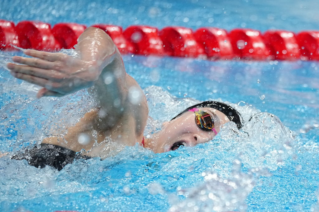 Rikako Ikee from Japan swims in Olympics heats in the women's 4 x 100 m freestyle at the Tokyo Aquatics Center.