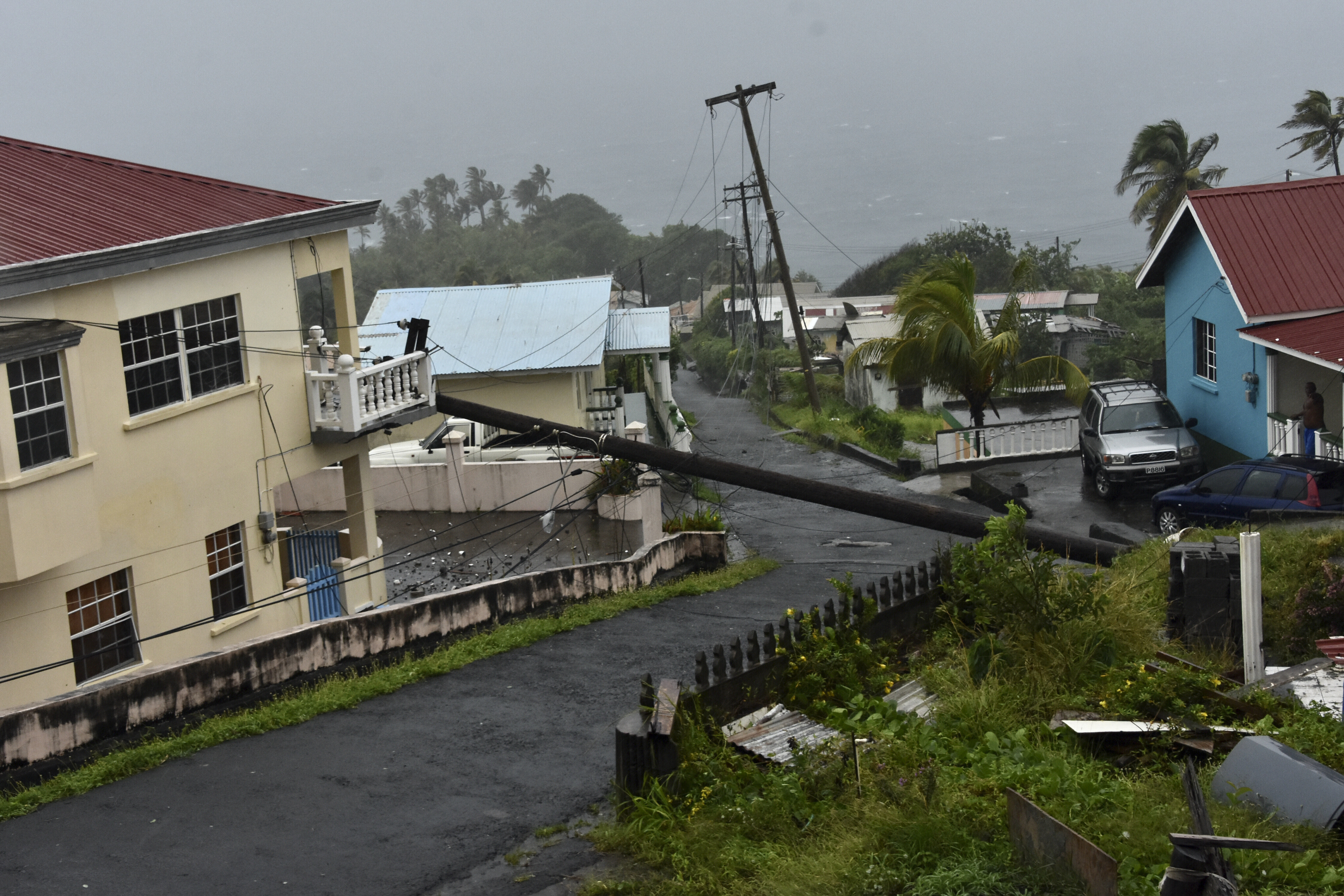 An electrical pole felled by Hurricane Elsa leans on the edge of a residential balcony, in Cedars, St. Vincent, on July 2, 2021.