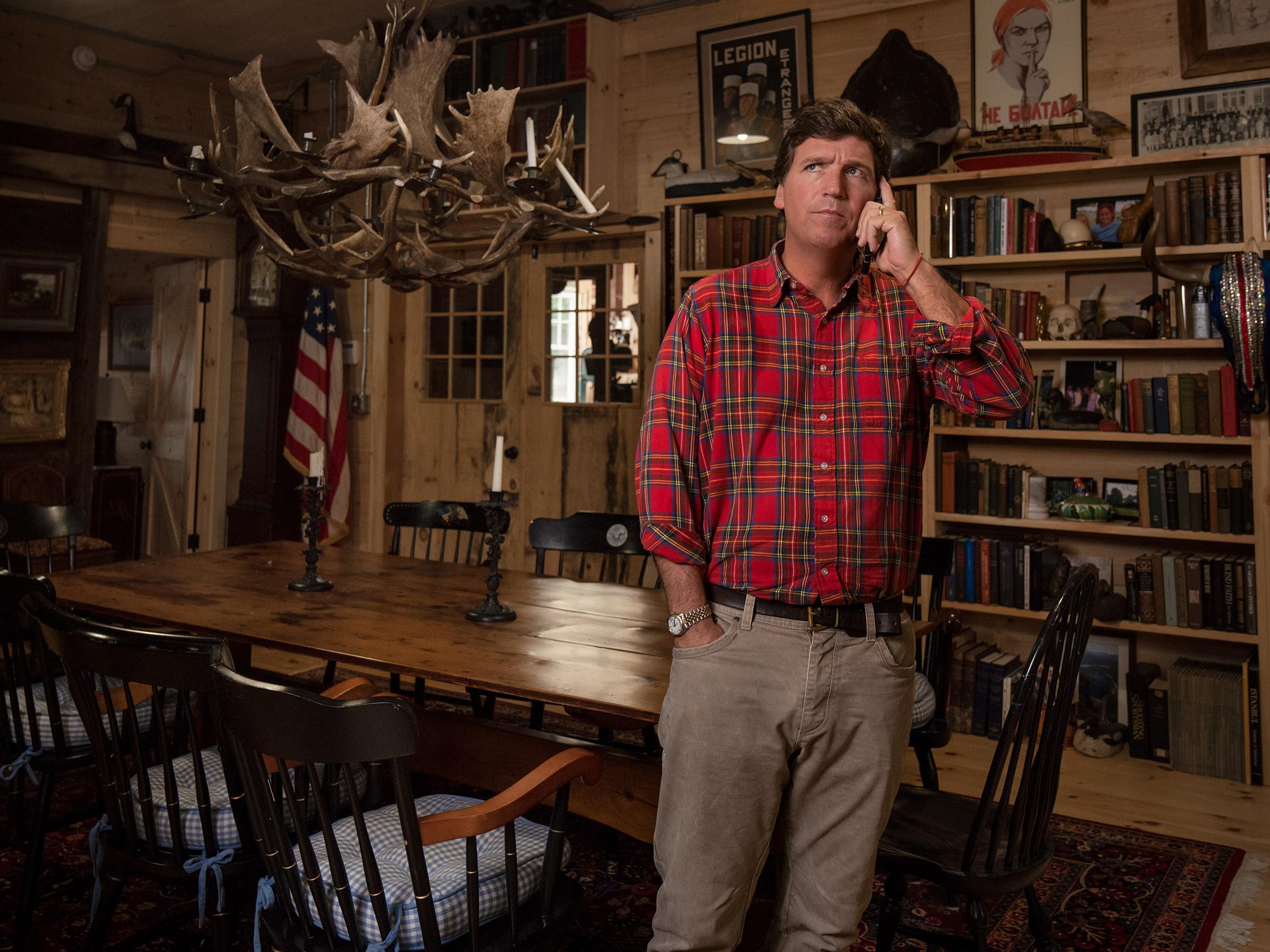 Carlson takes a call at his studio.