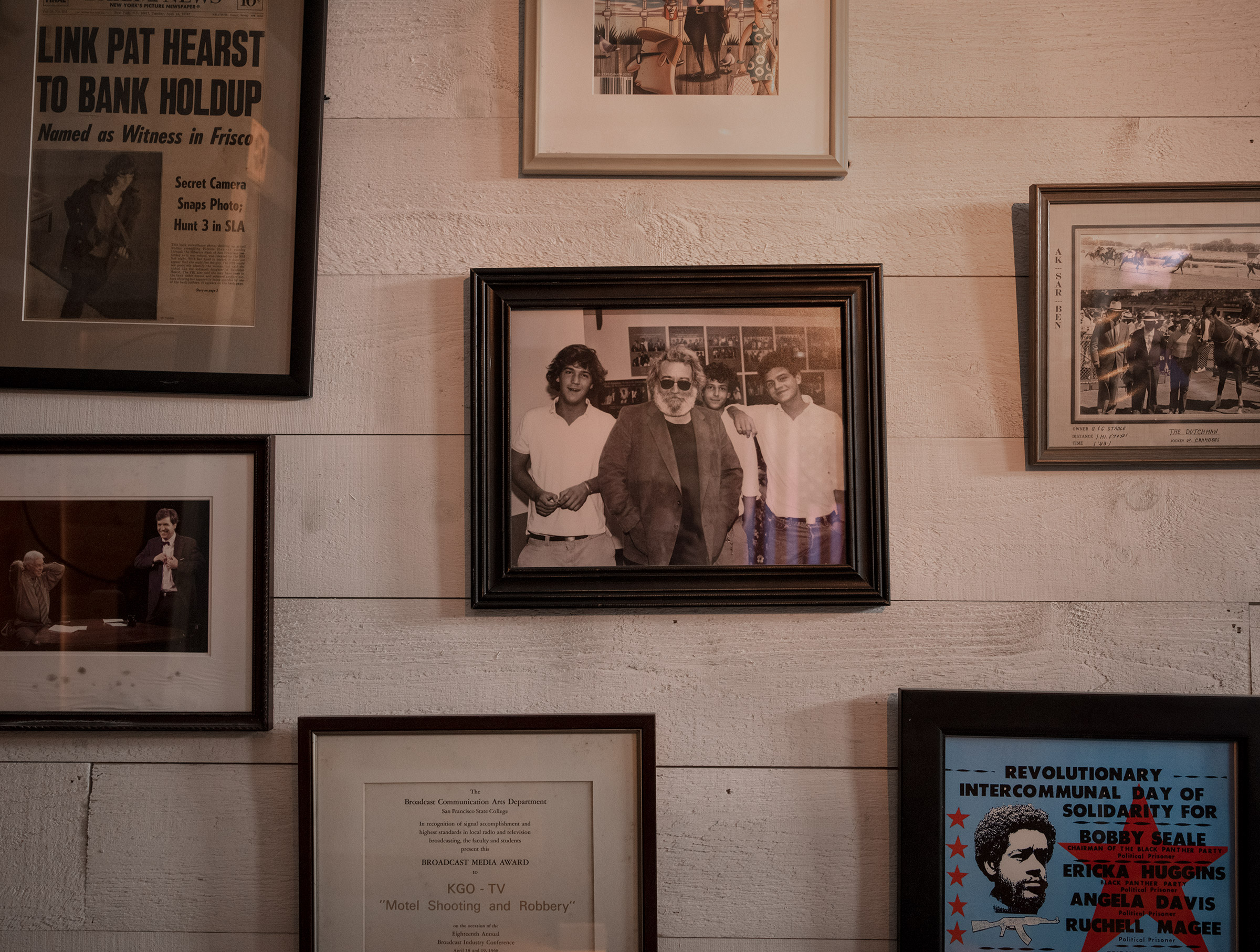 Carlson's studio is decorated with awards, antiques and photos—one from college with the Grateful Dead's Jerry Garcia.