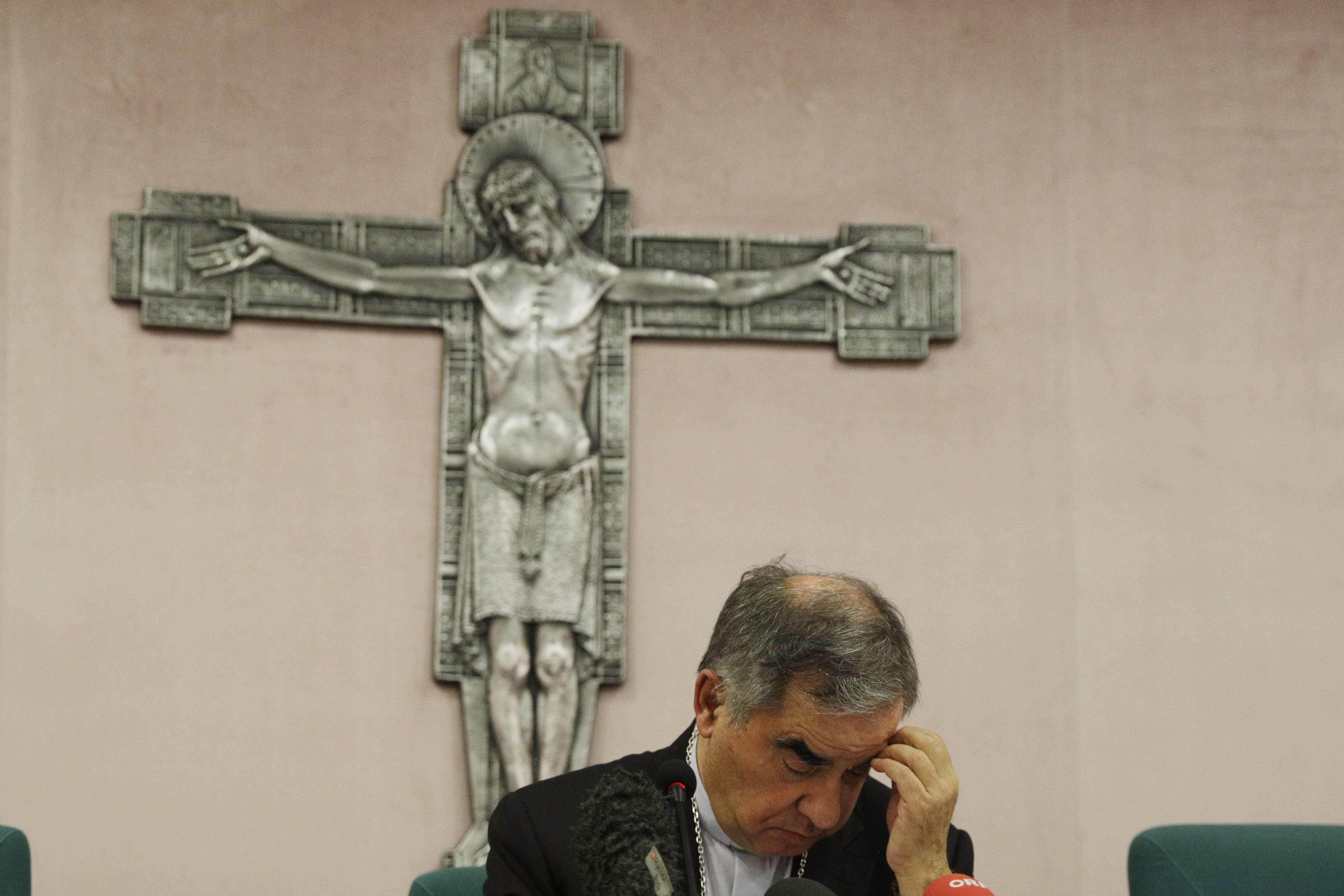Cardinal Angelo Becciu looks down as he meets the media during a press conference in Rome, Italy on July 3, 2021.