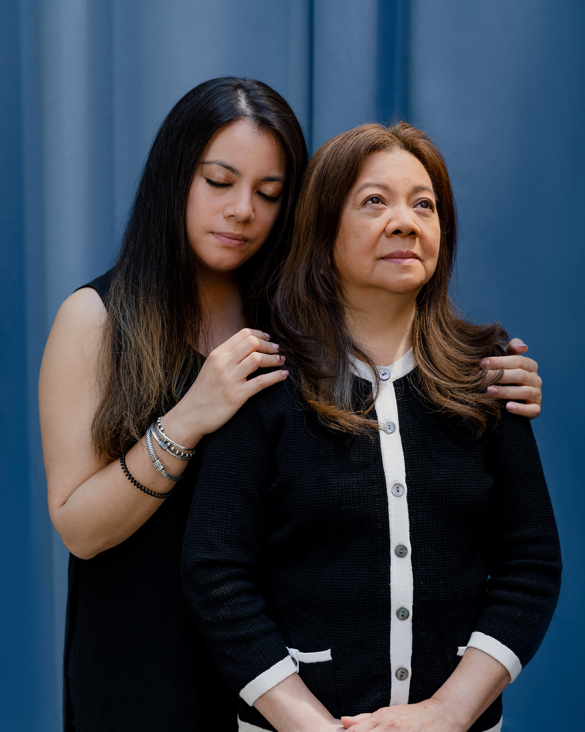 """'WHAT MAKES AMERICA SO BEAUTIFUL.' Elizabeth Kari, 32, closes her eyes as she holds her mother Vilma Kari, 66, inside her lower-Manhattan apartment building on May 21. It's a rare moment of rest for Elizabeth, who took a two-month leave from her fashion-industry job to be her mother's caretaker after Vilma was brutally attacked. On March 29, while she was walking to church, a man kicked her to the ground, stomped on her face and shouted, """"You don't belong here!"""" Because Vilma suffered serious injuries including a fractured pelvis, Elizabeth, her only child, moved her mother into her home and had to help her with basic tasks like sitting up, using the bathroom, even slowly adjusting her legs, inch by inch, to find less painful positions. """"The first week, every movement she made was with me,"""" says Elizabeth, who also assumed the role of her mother's emotional bodyguard, initially shielding her from any news coverage of the high-profile attack, which Vilma is still processing. """"This, I feel, is the scariest time for me to be an Asian,"""" says Vilma, who moved to the U.S. from the Philippines nearly 40 years ago. """"I never felt that before."""" In May, Elizabeth created a campaign called AAP(I belong) in her mother's honor to allow people who have encountered anti-Asian hate to anonymously share their stories online—and to subvert the attacker's racist phrase. """"I don't think it's anyone's right to tell anyone they don't belong in America. That's the cornerstone of what America is,"""" Elizabeth says. """"And that's what makes America so beautiful."""""""