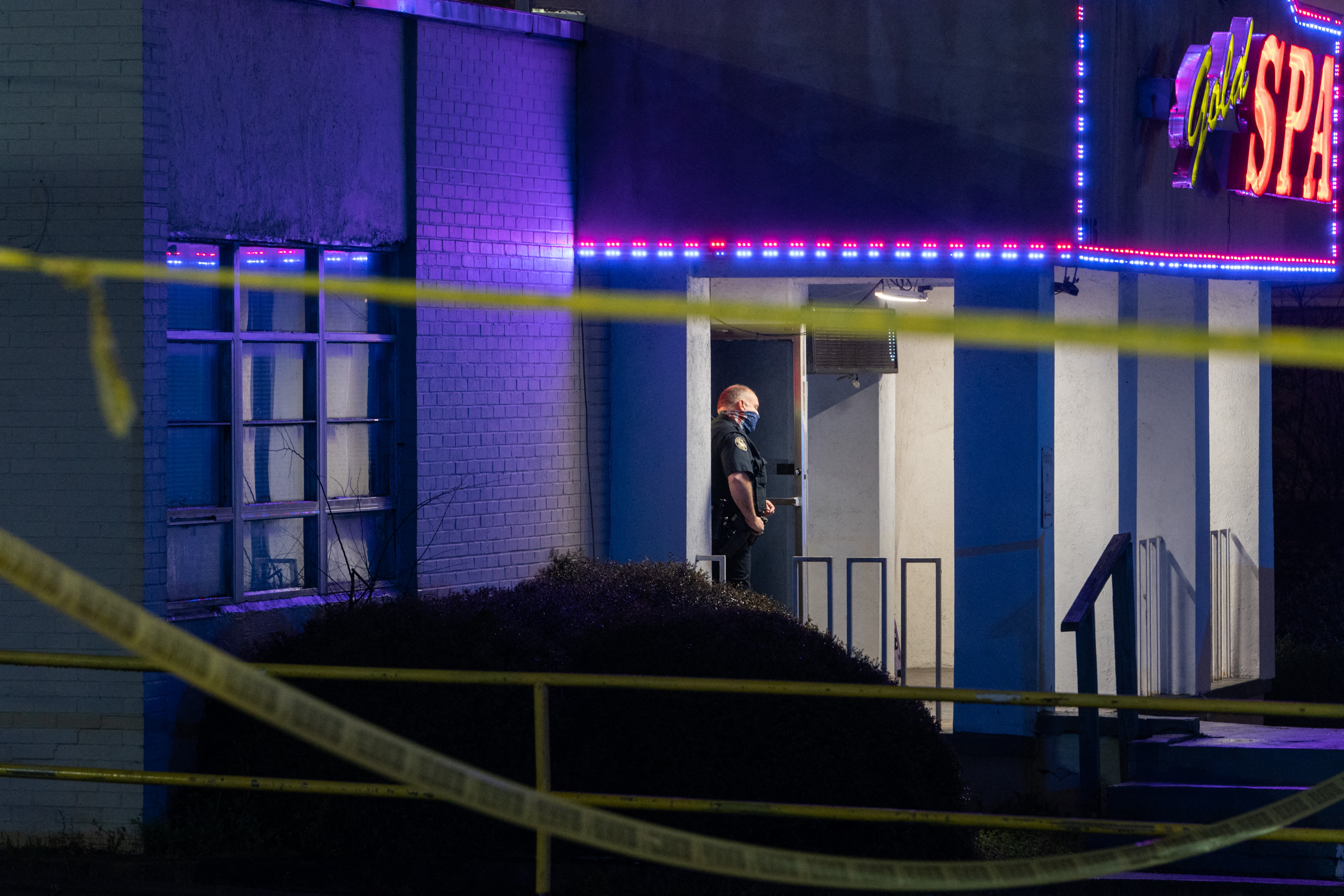 A police officer stands outside a spa where three people were shot and killed on March 16 in Atlanta, Georgia.