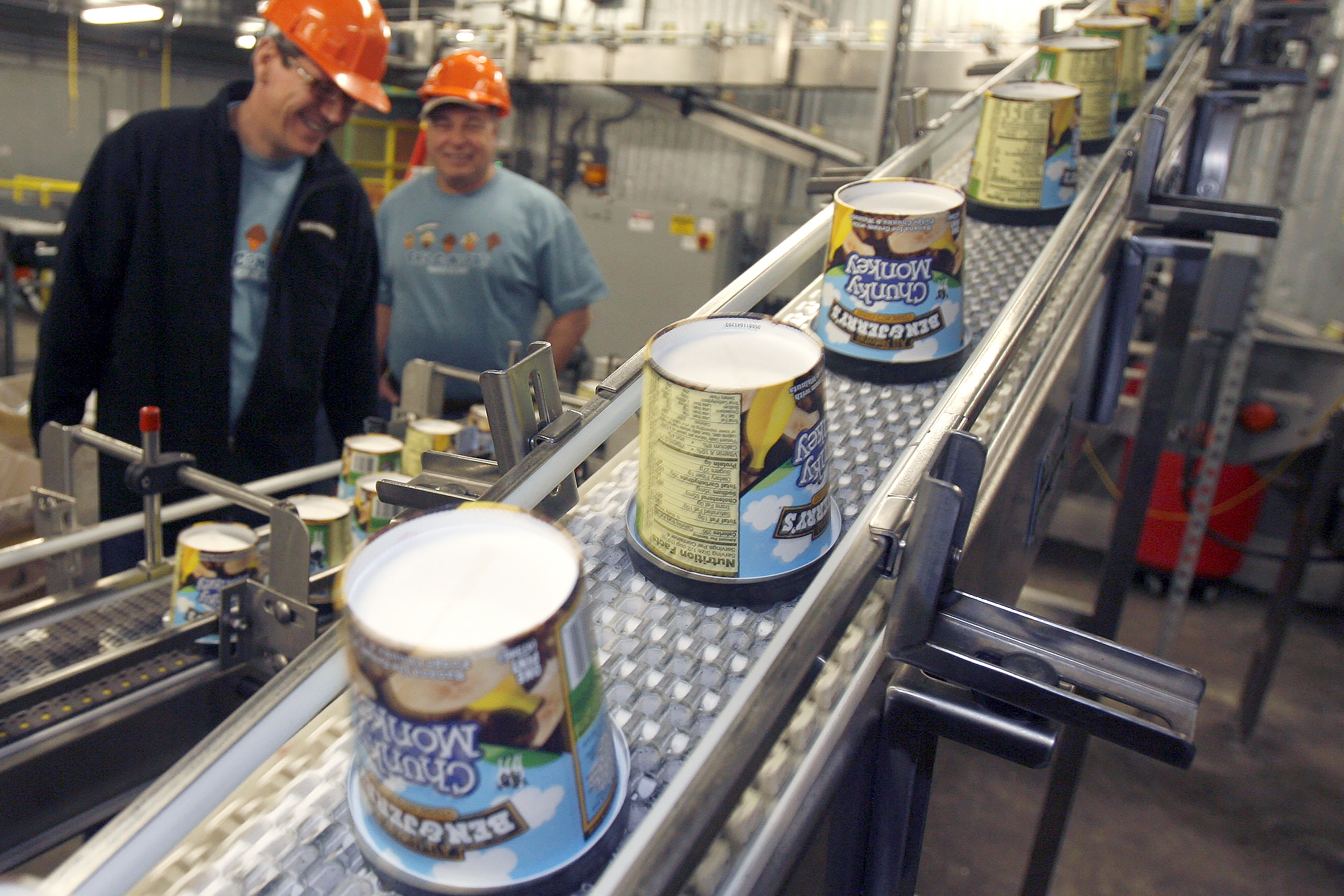 In this March 23, 2010 file photo ice cream moves along the production line at Ben & Jerry's Homemade Ice Cream, in Waterbury, Vt.