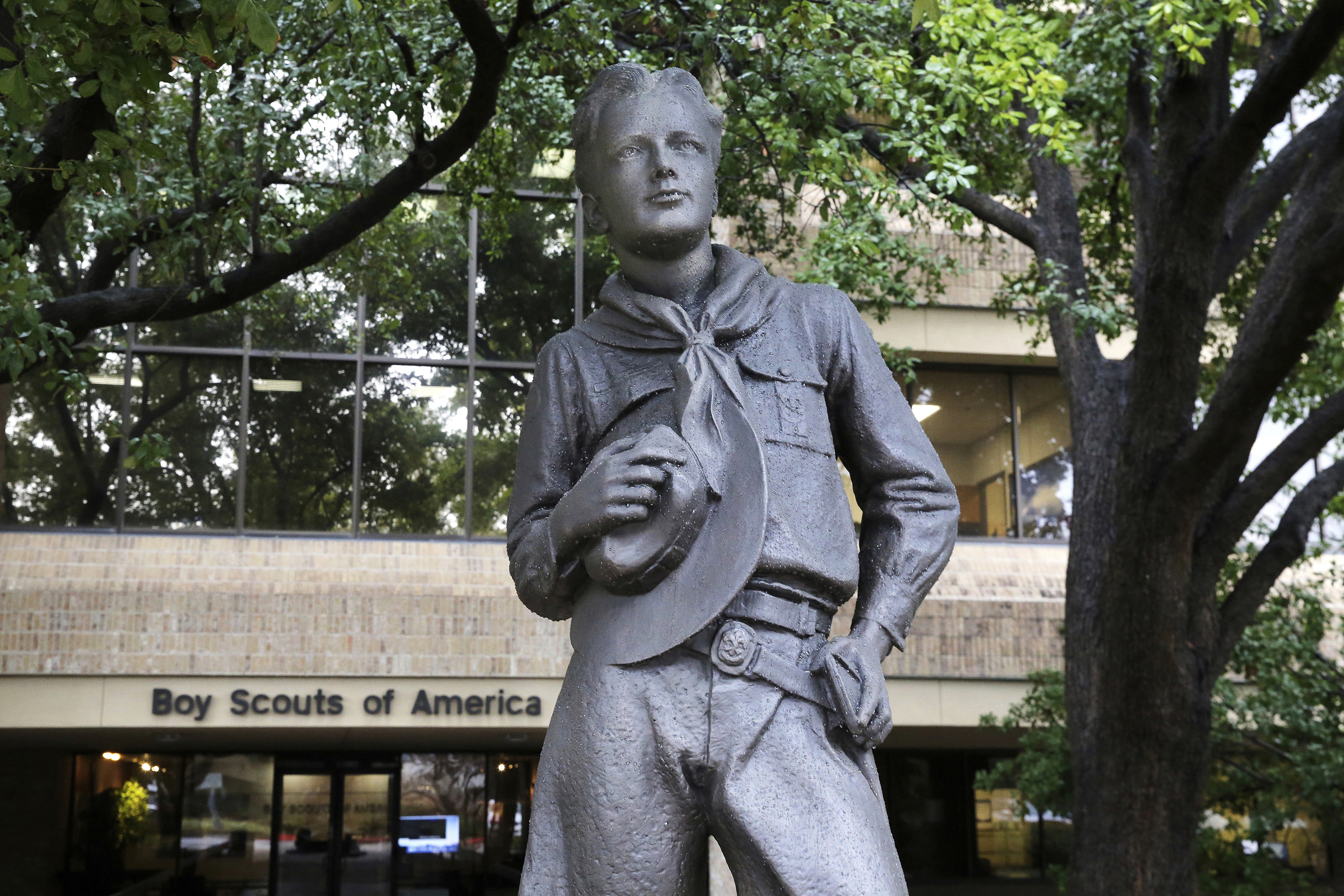 In this Feb. 12, 2020 file photo, a statue stands outside the Boy Scouts of America headquarters in Irving, Texas. The Boy Scouts of America have reached an agreement with attorneys representing some 60,000 victims of child sex abuse in what could prove to be a pivotal moment in the organization's bankruptcy case. Attorneys for the BSA filed court papers late Thursday, July 1, 2021 outlining a restructuring support agreement, or RSA, with attorneys representing abuse victims.
