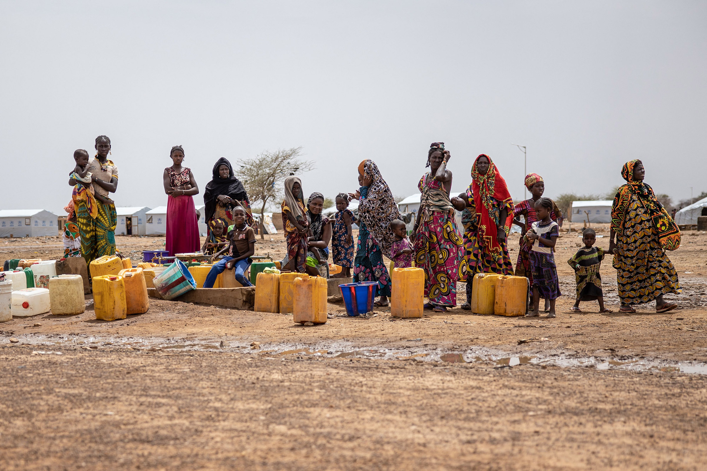 Women line up for water at Goudoubo camp in BurkinaFaso, on June20. The camp is sheltering thousands of Malians who have fled jihadist violence in the region.