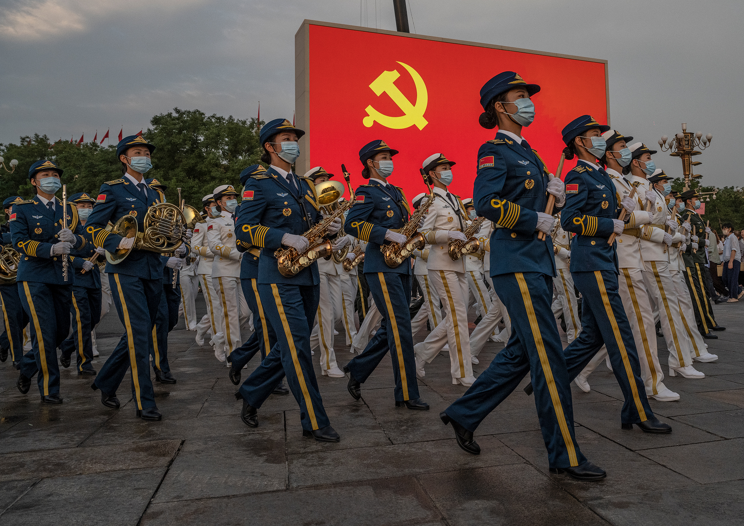 Female members of a People's Liberation Army ceremonial band march at a ceremony marking the 100th anniversary of the Chinese Communist Party in Beijing's Tiananmen Square on July 1.