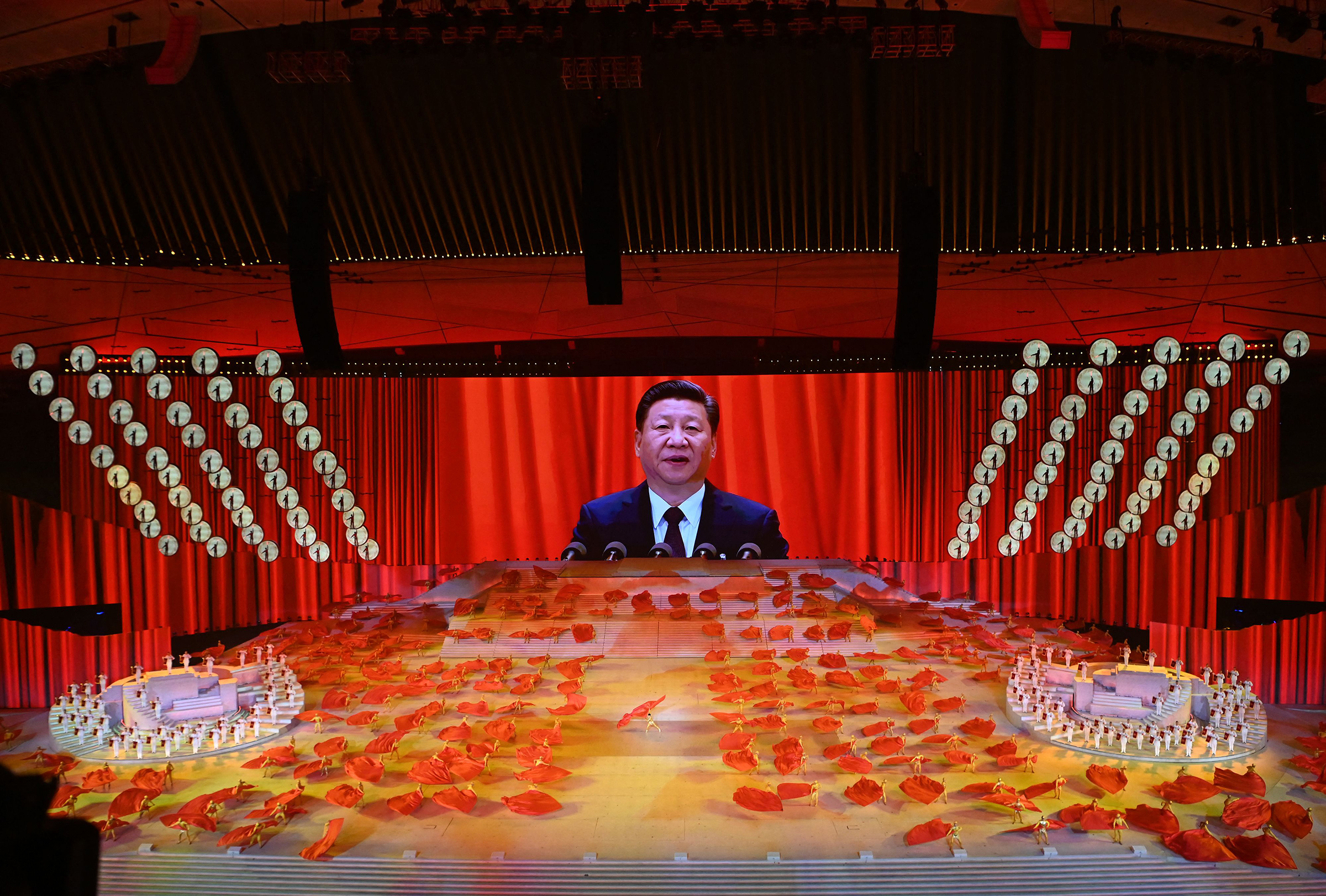 President Xi Jinping of China is seen on a large screen during a performance at the National Stadium in Beijing on June 28, 2021, as part of the celebrations of the 100th Anniversary of the founding of the Communist Party of China on July 1.