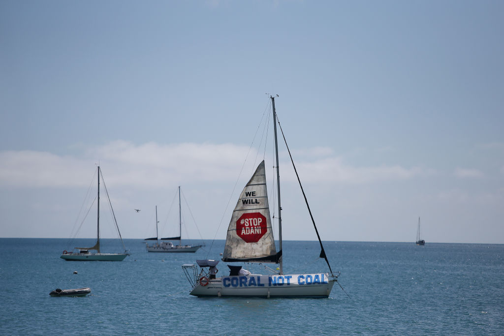 A boat launches a sail in protest to the Adani Carmichael Coal Mine proposal in Airlie Beach, Australia on April 26, 2019.
