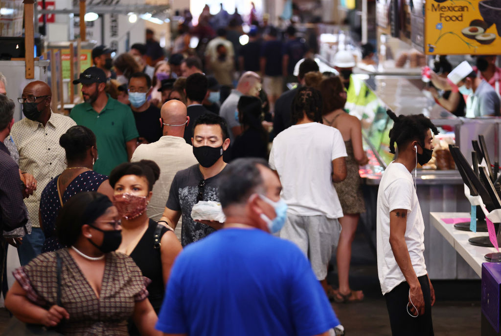 People wear face coverings in Grand Central Market on July 19, 2021 in Los Angeles, California. A new mask mandate went into effect just before midnight on July 17th in Los Angeles County