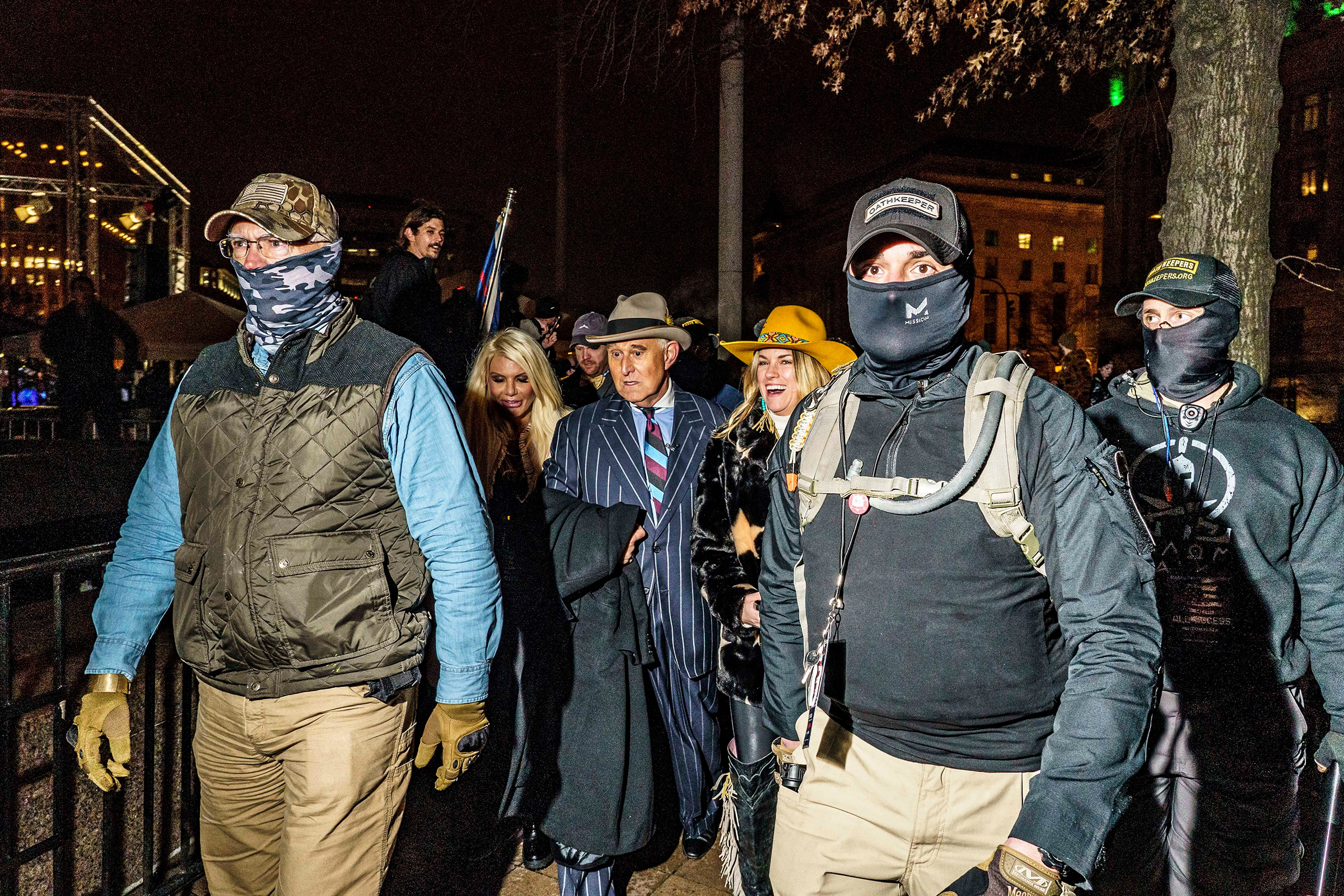 James, front right, and fellow Oath Keepers escort former Trump adviser Roger Stone to a rally in Washington the night before the insurrection