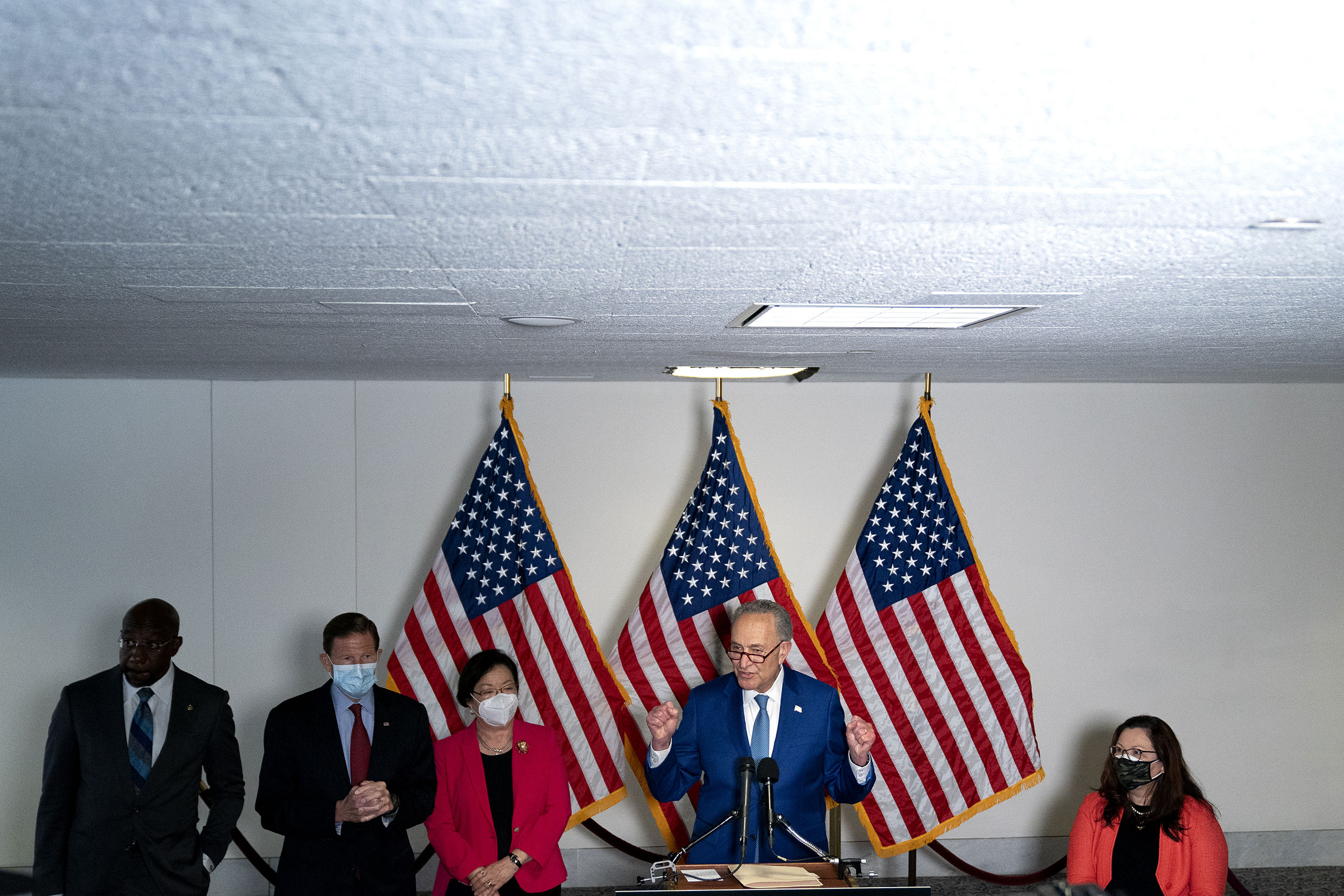 Senate Majority Leader Chuck Schumer, a Democrat from New York, center, speaks to members of the media following Senate Democratic policy luncheons in the Hart Senate Office Building in Washington, on April 20, 2021.
