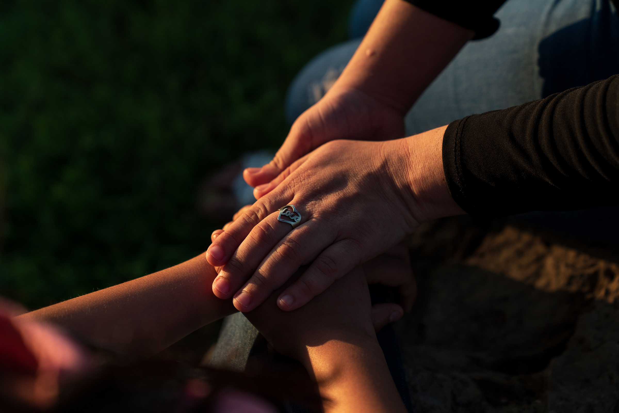 Estefani wears a ring, which she found in a river in El Salvador, that includes the word  Love.
